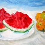 Fette di cocomero e frutta